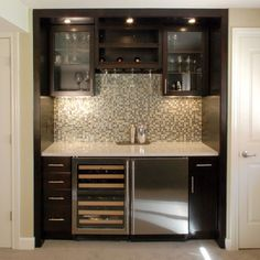 Do you need a drink?  Yes, yes I do.  Built-in bar instead of desk.