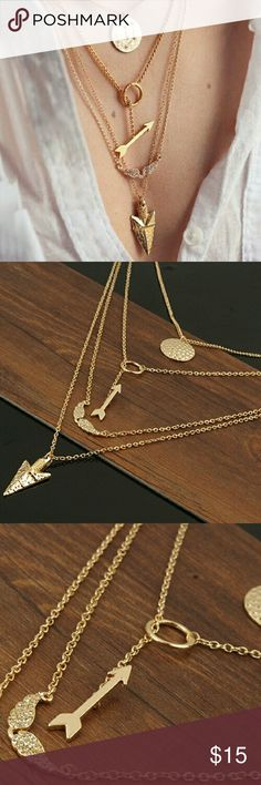Layered Arrows and Angel Wings Necklace ONE LEFT Gold tone metal alloy. 4 layers. Arrowhead, pave angel wings, circle and arrow lariat, and coin pendant. 14 inches with 4 inch extention. Trendy! Jewelry Necklaces