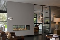 31 Stunning Modern Fireplace Design Ideas - There are many different ideas for creating modern fireplaces. In most instances, the fireplace is considered to be the focal point when it comes to i. Double Sided Gas Fireplace, Linear Fireplace, Freestanding Fireplace, Home Fireplace, Living Room With Fireplace, Fireplace Design, Fireplace Ideas, Corner Fireplaces, Fireplace Modern