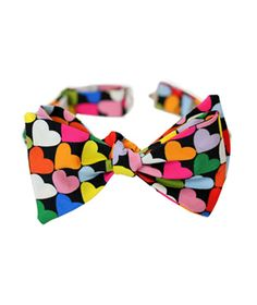 Heart to Heart Bow Tie  Formal enough for the tux; casual enough (when paired with jeans) for Saturday brunch.  To buy: $48, sfmoma.org.