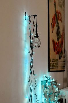 I hung up string lights over a mounted cage light in my home office and draped the rest of the lights over a vintage wooden ladder.
