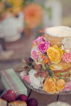 Natural cake decorated with flowers & berries