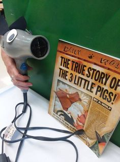 Use a hair dryer as the big bad wolf for retelling the story of the 3 Little Pigs!