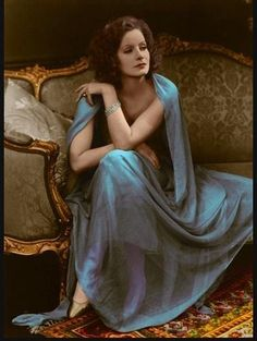 comfortable, elegant, and it looks like she's taking a break at a fabulous party. }} Greta Garbo