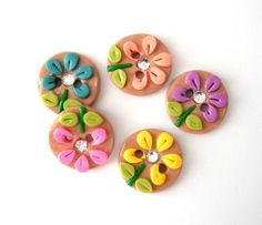 Button Spring Bling Flowers handmade polymer clay buttons ( 5 ). $7.50, via Etsy.