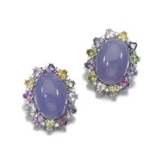 PAIR OF LAVENDER JADEITE, SAPPHIRE AND DIAMOND EARRINGS, MARGHERITA BURGENER Each centring on an oval lavender jadeite cabochon, within a surround of multi-coloured heart-shaped sapphires, highlighted with brilliant-cut diamonds, clip and post fittings, signed Margherita Burgener, Italian maker's mark, French import mark, case.
