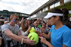Ana Ivanovic takes time out to sign autographs - Florian Eisele/AELTC