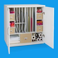 Hold all your hoops, mats, rulers and more with a mat and hoop cabinet. Plus, extra bins for storing your accessories.