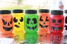 Used Trading Phrases' pumpkin faces on painted glass jars... they turned out adorable, and with a tea light in them they are beautiful Halloween Decor!