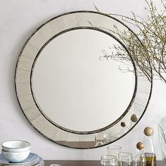 """Antique Tiled Round Mirror. Solid wood frame with Antiqued Bronze finish. Hand-inlaid mirrored glass tiles in a Bronzed Foxed-finish.30""""diam. x 1""""d. #westelm"""