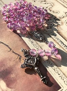 Excited to share this item from my shop: Handmade pink and purple mottled glass beaded Catholic Christening, Rosary Beads, Rosaries, Watercolor Pattern, Christmas Wrapping, Crucifix, Purple, Pink, Antique Silver