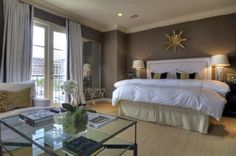 Great Master Bedroom!  Dark brown/grey walls, golden rich carpet, white drapes!