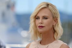Charlize Theron Lookbook: Charlize Theron wearing Medium Wavy Cut (3 of 134). Charlize Theron attended the Cannes photocall for 'The Last Face' wearing a platinum-blonde wavy 'do.