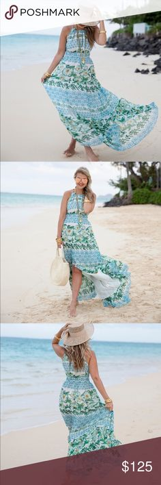 Eliza J Print Tiered Halter Maxi Dress A brightly printed maxi shaped from textured chiffon puts pretty shoulders on display and defines the figure with a banded Empire waist. A breezy slit at the tiered skirt offers a lovely flash of leg. Eliza J Dresses Maxi