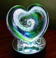 Just received my mom and dads memorial today and just want to thank y'all so much! They are absolutely beautiful! Mom and dad are together again and my sister and I will cherish these for the rest of our lives! I just can't thank you enough for this!  Kim  Artful Ashes... Your loved ones ashes memorialized within glass art... Greg and Christina  206-409-0337 www.artfulashes.com