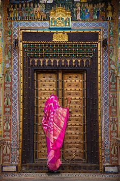 Woman in sari and beautiful door   Rajasthan, India