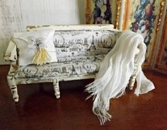 This is a wooden, French inspired painted, distressed, and aged Boudoir or Bedroom sofa in the Shabby chic style for your period Dolls house.