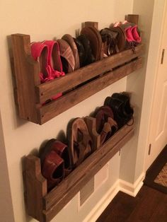 This listing is for one handcrafted wall mounted pallet-style shoe rack (two are pictured). These racks come with mounting screws and are preset for 16 inch-studs. Please feel free to request a different mounting configuration Dimensions: 35L x 11W x 5D Material: Handcrafted from whitewood and spruce boards Stained with your choice of Minwax wood stains Thanks for looking and feel free to visit our store to request a custom item! Be sure to check out our Facebook page