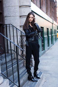 Black harem pants, loose top, leather jacket, booties