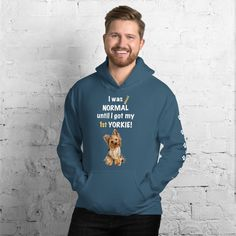 A new shirt for Yorkshire Terrier dad and parent from our new clothing collection, Almost normal, with white paw prints on the left sleeve. #yorkie #yorkshireterrier #yorkieclothes #yorkielover #yorkiehoodie #hoodie #doghoodie