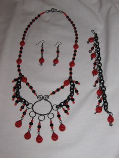 'Ladybug necklace, bracelet, earrings set' is going up for auction at 10am Mon, Aug 27 with a starting bid of $10.