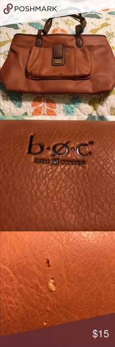 Ladies very nice B.O.C hand bag/purse Beautiful rust brown handbag in good condition has one scuff  in the faux leather as seen in pictures with matching Brown leather wallet. If you have any questions please feel free to ask I do except offers and please share my listings while you were here check out my closet I have lots of great deals and happy polishing (B.O.C. ) brand b.o.c. Bags Satchels