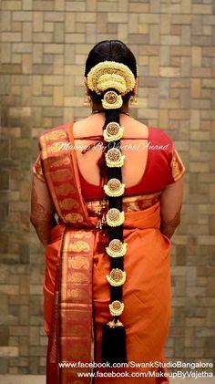 Traditional Southern Indian bride's bridal braid hair. Hairstyle by Swank Studio. Silk Saree. Sari Blouse Design. Hair Accessory. Temple jewelry. Jhumkis. Silk Kanjeevaram sari. Braid with fresh flowers. Tamil bride. Telugu bride. Kannada bride. Hindu bride. Malayalee bride. Find us at https://www.facebook.com/SwankStudioBangalore