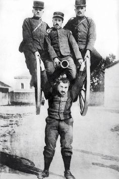 WWI era French Army private carries 3 officers and a cannon as part of training excercise.