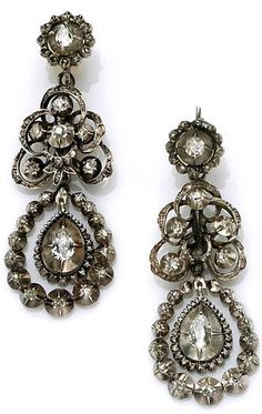 A pair of antique diamond pendant earrings, circa 1880 each designed as three detachable openwork sections of old European and rose-cut diamonds; can be worn multiple ways; estimated total diamond weight for the pair: 1.35 carats; mounted in silver.