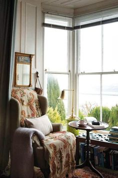 Imagine this classy, cozy reading nook on a rainy day! I could read or write here, and drink coffee or tea, all day!