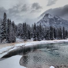 Rundle Mountain and the Bow River after a snowfall Canadian Forest, Banff, Mount Rainier, Road Trip, Bow, Canada, River, Mountains, Places