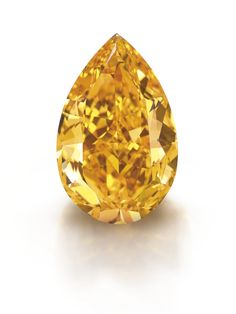 THE ORANGE, a 14.82-carat fancy vivid orange diamond, set two world records as it sold for more than $35.5 million