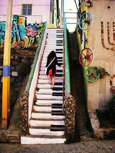Piano Stairs, how cool this be to paint on a wooden stair case in your home! These piano stairs along with the graffiti background brings a classical instrument with a hip and urban feel. Piano Stairs, Basement Stairs, Piano Room, Book Stairs, Attic Stairs, Painted Stairs, Stenciled Stairs, Painted Staircases, Spiral Staircases