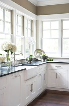 dark floors, white cabinets, black counters and the wall color! Tons of light :-)