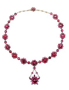 Antique rose cut garnet cluster pendant necklace, c.1800,   the series of flowerhead clusters set with round cut stones, single stones in between, hung with a star shaped flowerhead pendant, close set, later chain extension sections to the back