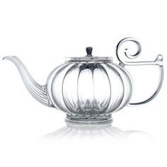 "Hand blown glass with silver lid made in France by ""Numbered Teapots"". It brings to mind all the delights of a mild flirtation, just as it brings to the mouth rich flavours and heady aromas. In its wake it leaves an evocative swirl of shared moments and soft light."