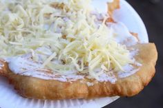 """What it is: A plate-sized sheet of fried dough that is usually smothered with sour cream and cheese. Other possible toppings include garlic sauce or ketchup.Why it's awesome: Did you miss the part where I wrote """"fried dough""""?Get a recipe [here]. Hungarian Cuisine, Hungarian Recipes, Hungarian Food, Croatian Recipes, German Recipes, European Dishes, European Cuisine, Good Food, Yummy Food"""