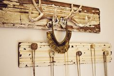 Necklace display...not feelin the horns so much but love the distressed wood and cute knobs.