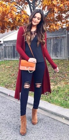 dc32b6784ff5 women s red cardigan with black v-neck top and black distressed fitted jeans  and brown boots outfit