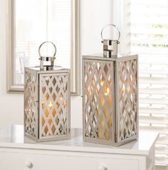 """modern unique stainless steel candle lamps.  Large 20"""" tall & the medium is 17"""" high. Beautiful shine silver LATTICE with glass panes. Candle holder Lantern Lamp outdoor terrace patio or as wedding decorations and event centerpieces. Found under $36 at gifte-mart.com"""