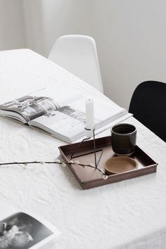 Monochrome dining room slow living tea, Kinfolk home and candle on copper tray