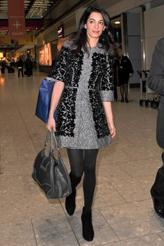 What: Oscar de la Renta dress When: October 24, 2014 Where: London Heathrow Airport   - HarpersBAZAAR.com
