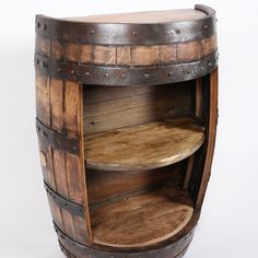 Buy half barrel hide away a whiskey barrel furniture made from authentic whiskey aged barrels. Display your decor or whiskey collection while hiding away your secrets in this unique two shelf half barrel cabinet. Half Whiskey Barrels, Whiskey Barrel Sink, Aged Whiskey, Wine Barrels, Bourbon Barrel Table, Wine Barrel Bar, Wine Barrel Chairs, Whiskey Barrel Furniture, Rustic Furniture