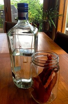 """How to Make Bacon Infused Vodka...everything about this just screams """"Wrong!"""" to me but I bet it would make a delicious Bloody Mary...or a BLT martini with Bloody Mary mix and some basil or cilantro muddled in for the """"L"""" instead of lettuce...,hmmmm...."""