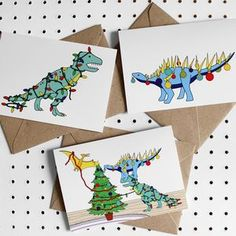 Deck The Dinos Dinosaur Christmas Greeting Card Pack.  Christmas greeting cards are one of our favourite traditions. Discover unique, inspiring Christmas cards that are sure to stand out.