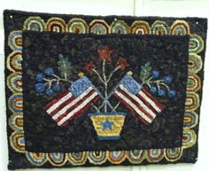 """Cedar Lakes Flag Rug"" pattern by Judy Cripps, hooked by Marie McDonald"
