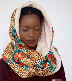 Handmade This beautiful chunky, hooded ankara infinity scarf is so cosy and comfortable to keep you warm in the cold. The hooded scarf is 43 inches long and 16 inches wide, so you can wrap it around to fill the neck as hoodie or just a scarf. Each of my items are individually crafted to the highest quality.