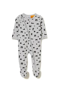 The diagonal zip of this mini zip through romper allows for quick changing with an inner zip backing to protect baby's skin from any catches. Available in many different colours and prints! Made from a soft stretch cotton.% COTTON 5% ELASTANE