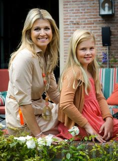 Dutch Queen Maxima and Crown Princess Amalia during a photo session at their residence Villa Eikenhorst in Wassenaar, 19 July 2013