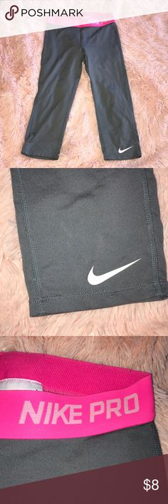 **NIKE LEGGINGS** These are children size large Nike Pro leggings that are gray and pink. In good condition. Nike Bottoms Leggings